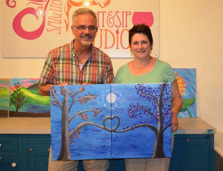 a couple who painted complementary paintings that fit together at a paint & sip partners in crime party