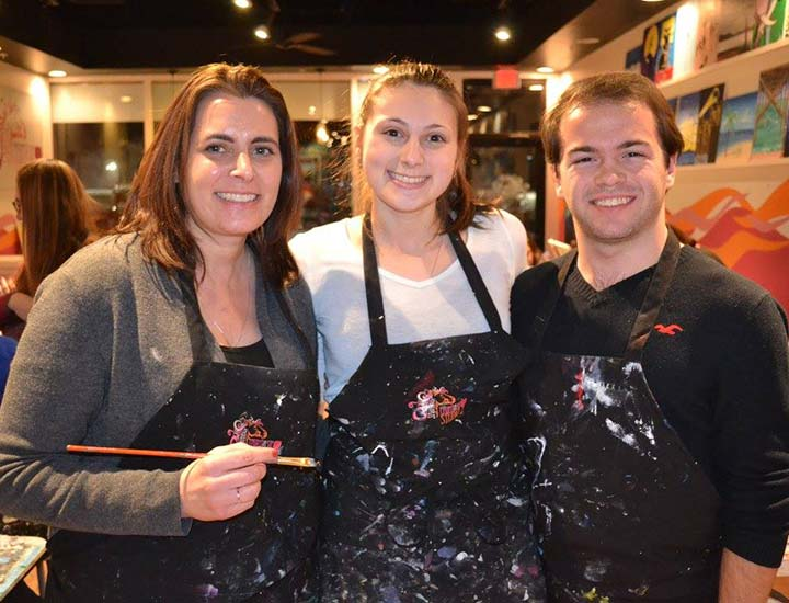 three painters at a paint & sip party