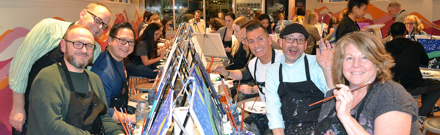 men & women painting at the Saratoga Paint & Sip Studio in Latham