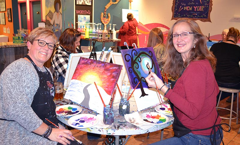 two women painting at the Saratoga Paint and Sip Studio in Latham, NY