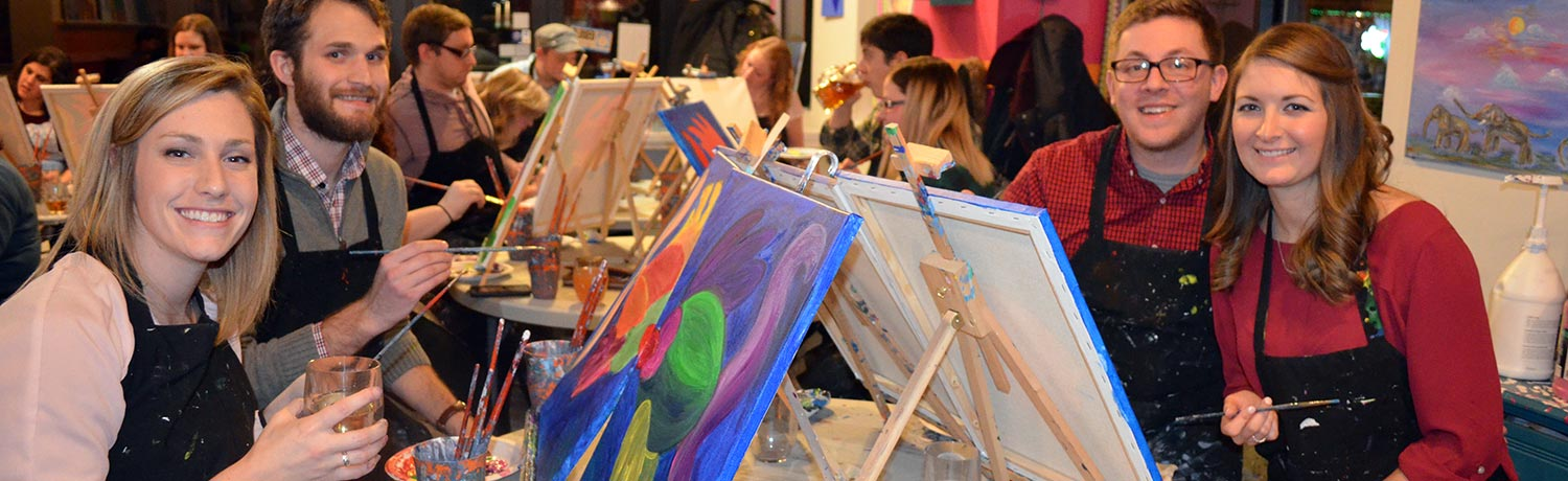 two couples drinking wine and painting at one of Paint & Sips convenient locations