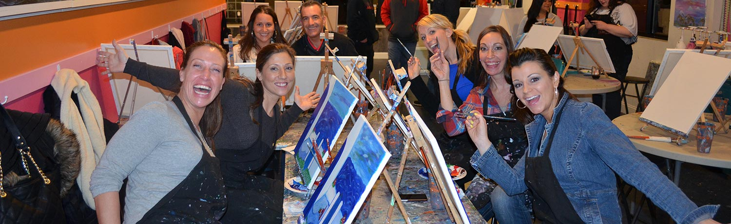 a group of people finishing their paintings at a Saratoga Paint & Sip class