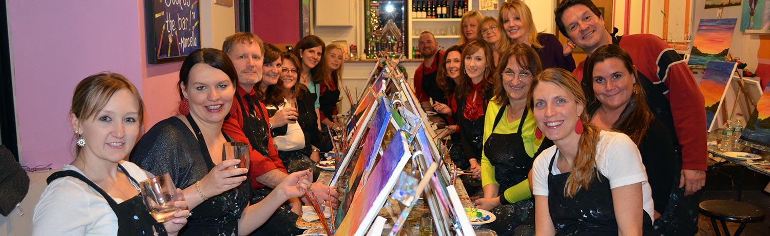 a group of people drinking and painting at one of the Paint & Sip studios