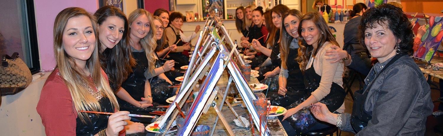a group of women painting masterpieces that can be shared in the Paint & Sip Gallery