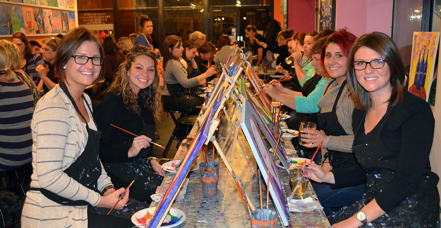 a group of women at the area's original Paint & Sip Studio!