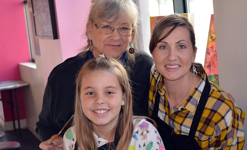 a grandmother, mother & daughter at Saratoga Paint & Sip Studio